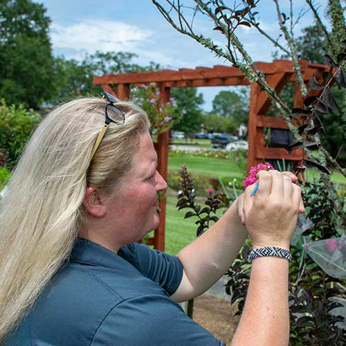 student working with flowers